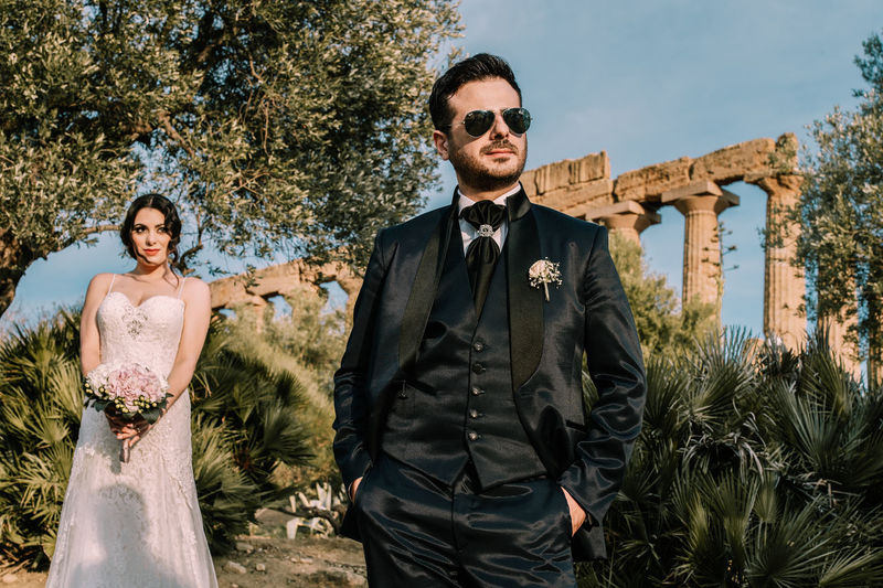 Adult Couple - Relationship Fashion Front View Glasses Looking At Camera Males  Men Mid Adult Mid Adult Men Nature Outdoors Plant Portrait Standing Sunglasses Three Quarter Length Togetherness Two People Young Adult Young Men