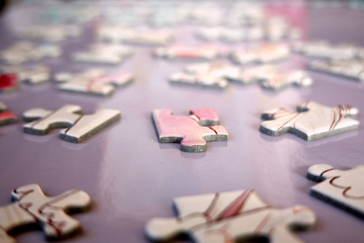 Close up of jigsaw puzzle pieces on table