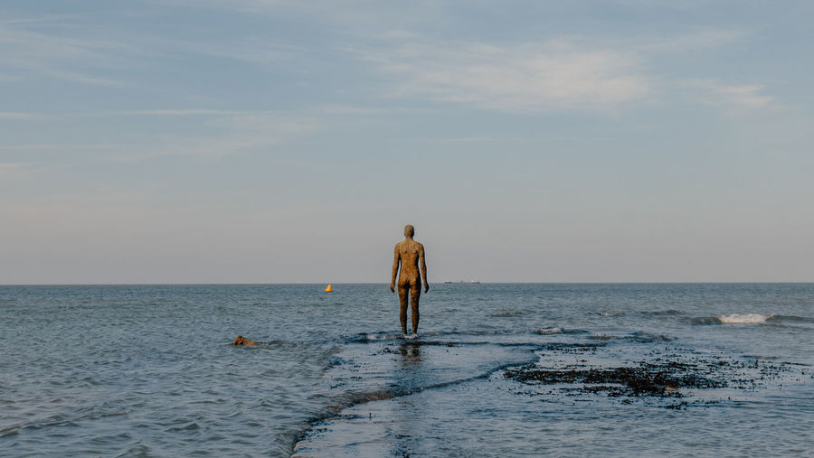 The Antony Gormley sculpture, Another Time, stands in the sea as the tide begins to come in on the public beachfront in Margate, England, in February, 2019. Sea Water Horizon Over Water Sky Horizon Rear View Beauty In Nature Scenics - Nature Waterfront One Person Lifestyles Nature Standing Men Tranquil Scene Beach Tranquility Outdoors Sculpture Antony Gormley Gormley Ocean Tranquil Sunset