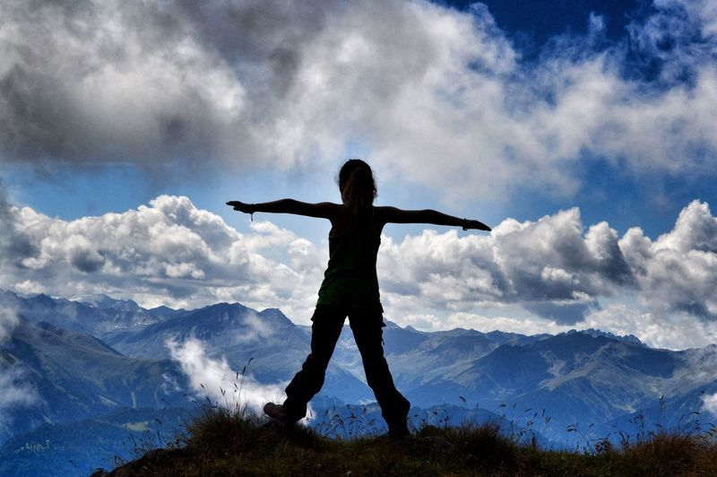 Hiking Cloud - Sky Sky Arms Outstretched Rear View Mountain Real People One Person Nature Arms Raised Standing Leisure Activity Full Length Beauty In Nature Outdoors Scenics Day Mountain Range Lifestyles Snow