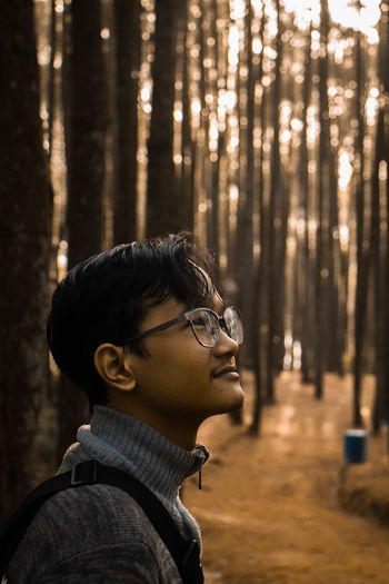 Portrait of young man in forest