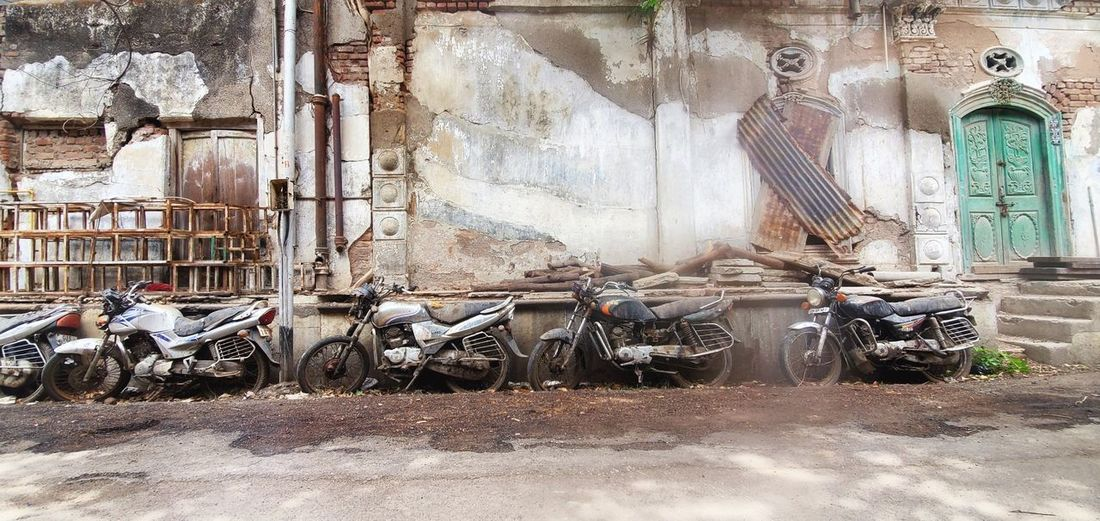 Bicycles parked against wall in city