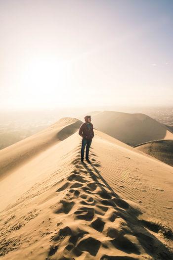 Full length of man standing on desert land