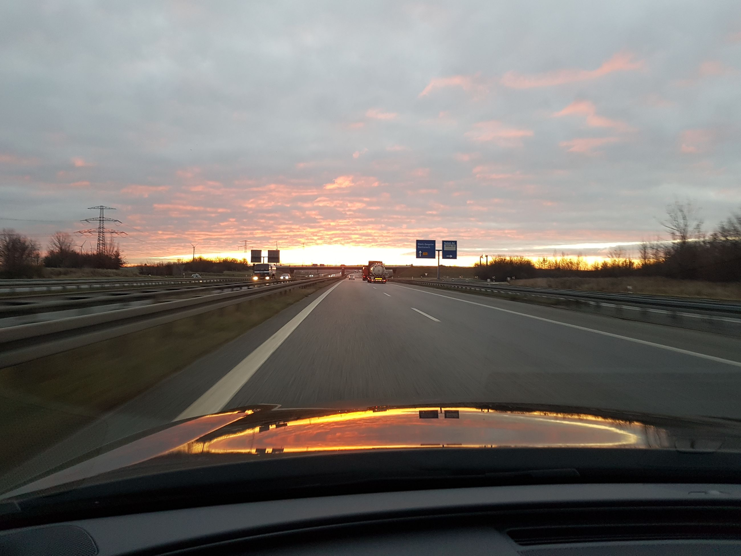 car, driving, transportation, road, the way forward, travel, windshield, sunset, car point of view, cloud - sky, mode of transport, highway, car interior, blurred motion, sky, two lane highway, motion, land vehicle, no people, speed, outdoors, vehicle mirror, day
