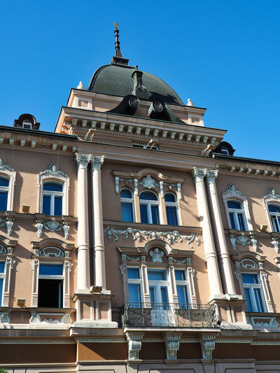 European Cities Novi Sad Serbia Eastern Europe Balkans Europe Outdoors Street Photography Travel Destinations Clear Blue Sky Architecture Public Places Facades Sunlight Built Structure Building Exterior Low Angle View Building Window No People History The Past Day City Ornate Architectural Column