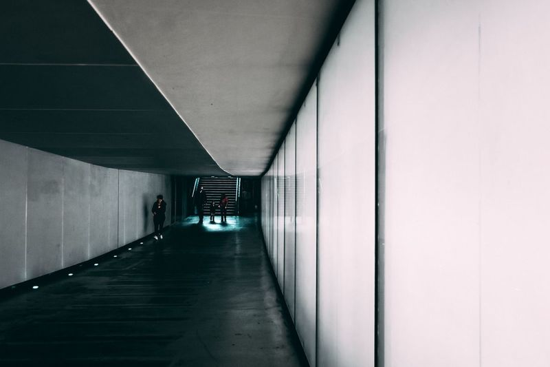 People Walking In Underground Walkway