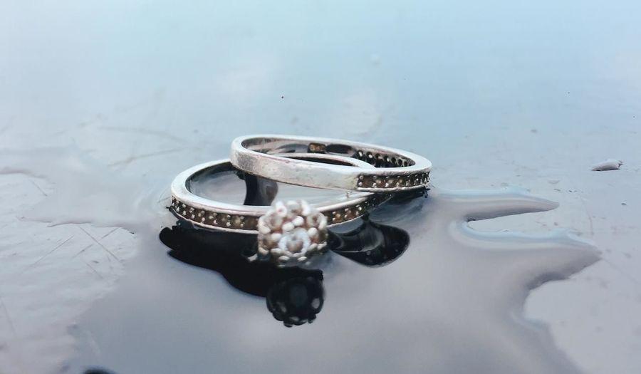 High angle view of wedding rings on beach