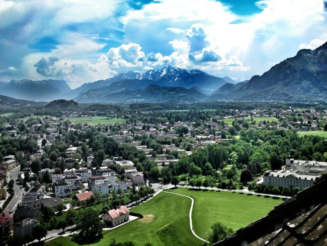Salzburg, Austria View From The Schlossberg In The Background : The Alps with Eternal Ice Clouds And Sky Sunlight And Shadow Cityscape Landscape Mountains Fog In The Mountains High Noon Outdoors