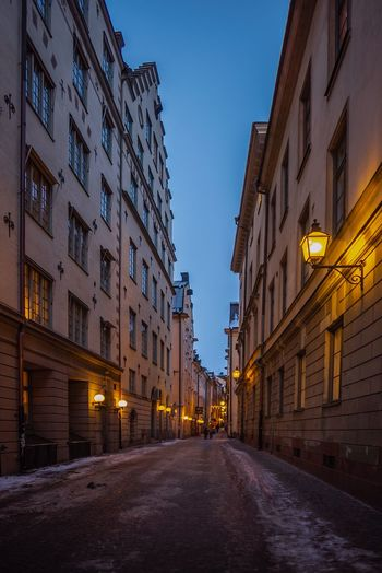 Gamla Stan, the old town of Stockholm Lowlight Old Town Perspectives Apartment Architecture Building Building Exterior Built Structure City Direction Dusk Illuminated Light Nature Night Outdoors Residential District Road Sky Street Street Light The Way Forward Transportation Window