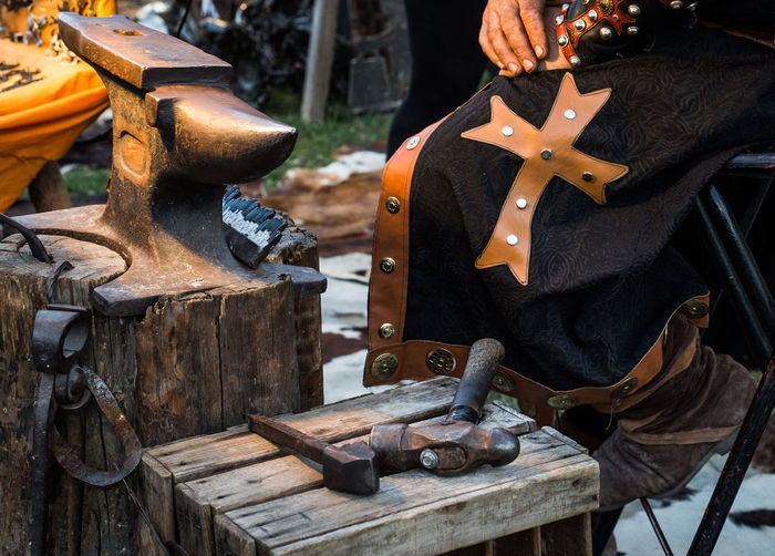 Detail of medieval blacksmith's clothing and tools in the traditional yearly Medieval Market celebration in Puebla de Sanabria. Zamora. Spain. Blacksmith  Medieval Smithy Hammer Chisel Metal Forge  Old Iron Steel Craft Fire Man Ancient Hand Work Working Historic Anvil Craftsmanship  Handicraft Festival