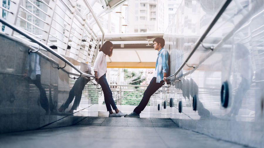 Young couple having a quarrel on during the trip together Full Length Real People Architecture Built Structure Two People Day People Men Indoors  Building Young Adult Adult Side View Lifestyles Women Young Men Standing Casual Clothing
