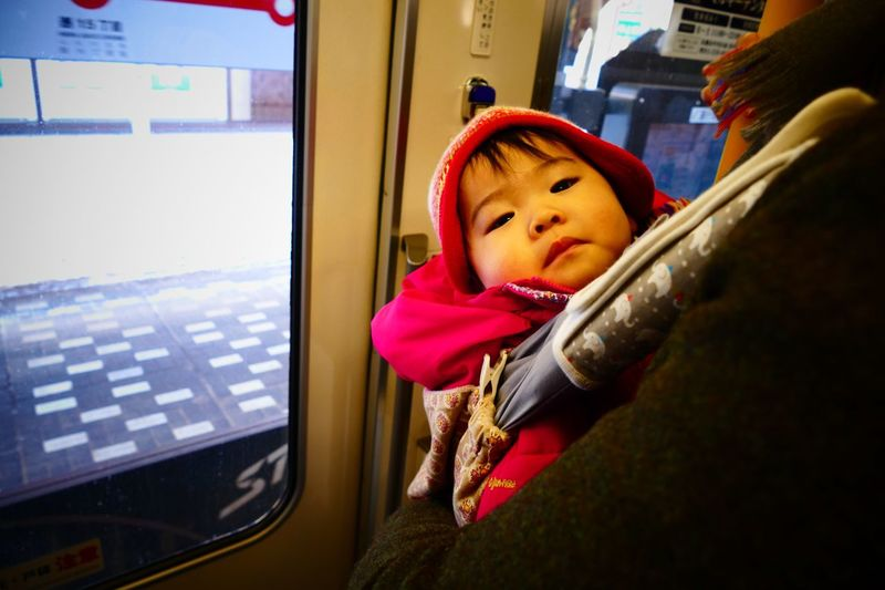 Portrait of baby in metro train