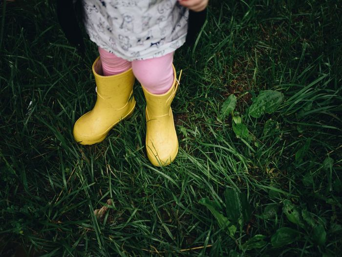 Low section of girl standing on grass