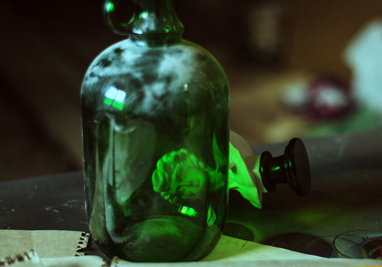 Close-up Indoors  Focus On Foreground Green Color No People Glass - Material Representation Human Representation Table Bottle Transparent Still Life Craft Selective Focus Art And Craft Green Single Object Art ArtWork Art And Craft