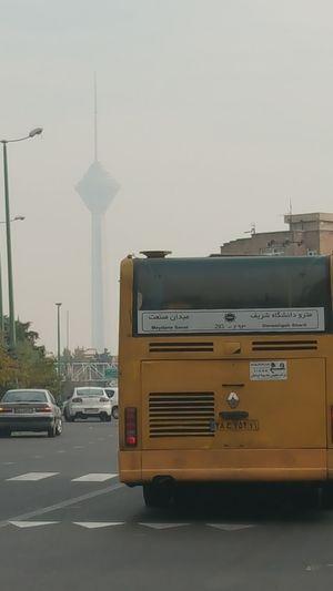 اینجا برای از تو نوشتن هوا کم است.... Tehran, Iran Milad Tower Tower City Day Sky Mobilephotography Contamination Air Bus Car Yellow Yellow Bus  آلودگی_هوا آلودگی تهران تهرانگردي برج_میلاد شهرک_غرب اتوبوس ماشین هوا آسمان
