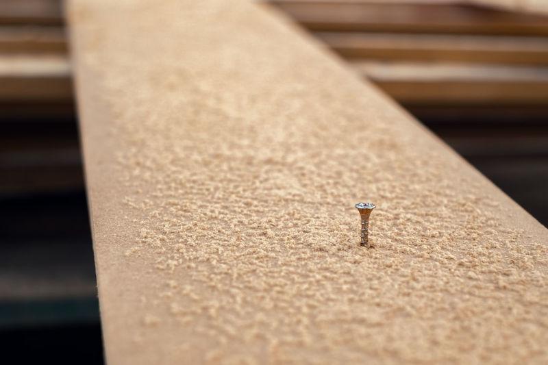 Close-up of nail on wood