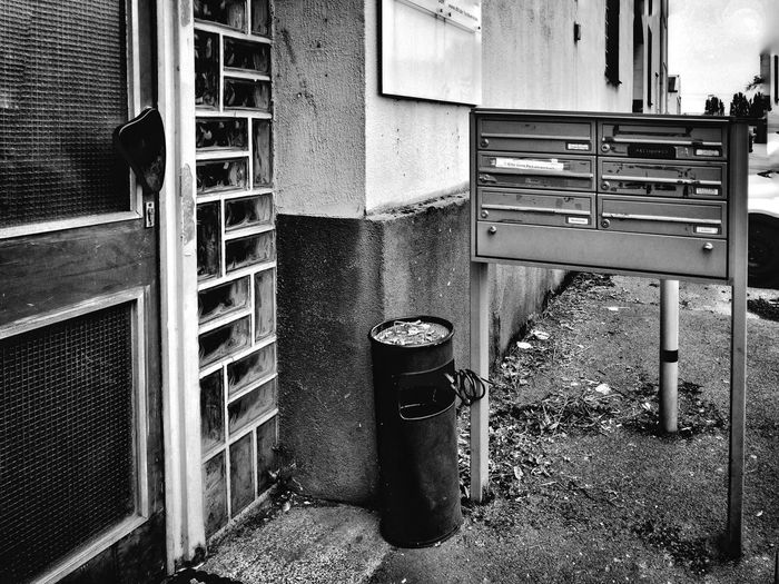 Duisburg, Germany - August 2nd 2017: typical house from the seventies Architecture Built Structure No People Documentary Ruhrgebiet Settlement Living Lying Trash Ashtray  Letter Box Glas Bricks German Typical Retro Old Seventies Flat House Architecture Door Black And White Monochrome Seventies