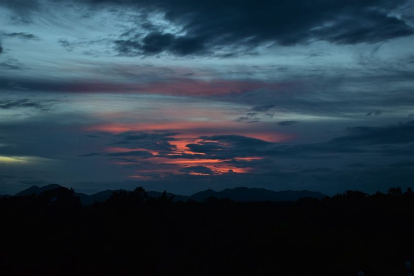 sunset in mountains Beauty In Nature Cloud - Sky Dark Dramatic Sky Environment Idyllic Landscape Majestic Nature No People Non-urban Scene Orange Color Outdoors Overcast Scenics - Nature Silhouette Sky Sunset Sunset In Mountains Tranquil Scene Tranquility