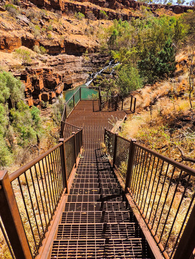 Karijini National Park, Western Australia 🇦🇺 Travel Destinations Travel Landscape Nature Australia Western Australia Green Color Rock - Object Tree Waterfall Water Red Stone Rock Forest River Karijini National Park Australia Australian Landscape Shadow Sunlight High Angle View Pathway Woods Walkway Stairway The Way Forward Railing Hand Rail