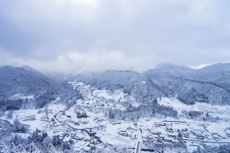 Snow Winter Cold Temperature Mountain Cloud - Sky Scenics - Nature Sky Landscape Environment Nature Beauty In Nature Mountain Range City Tranquil Scene Architecture No People Day Tranquility Outdoors Snowcapped Mountain