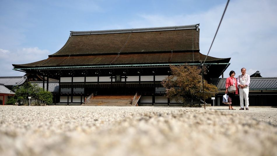 Imperial Palace Kyoto Architecture History People Walking Outdoors Day Built Structure Travel Destinations Adult Building Exterior Full Length Sky Japan Kyoto Imperial Palace Japan Imperial Palace Travelling Travel Photography Adventure Architecture Travel Tradition Epic Awesome
