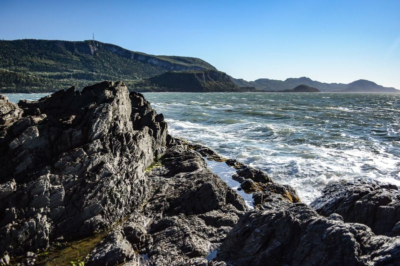 Rock Sea Sky Water Rock - Object Beauty In Nature Solid Scenics - Nature Mountain Nature Land No People Clear Sky Tranquil Scene Day Beach Tranquility Rock Formation Outdoors Rocky Coastline Power In Nature