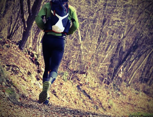 Athlete runner from behind with vintage effect during the racing race Alone Country Lomography Racing Run Running Adult Adults Only Athlete Effect Fitness Forest Lifestyles Lomo Mountain One Person Outdoors Race Real People Runner Sports Clothing Trail Training Tree Vntage