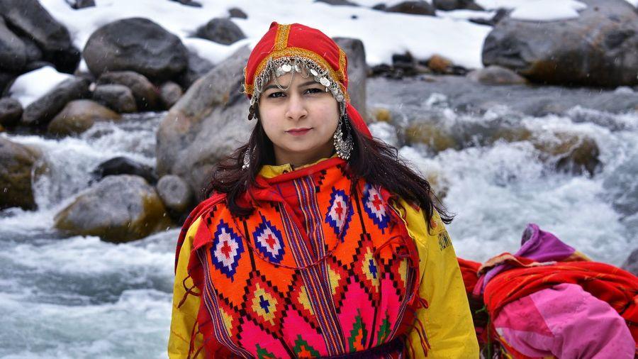 Beautiful girl in traditional wear in snow fall in manali / india
