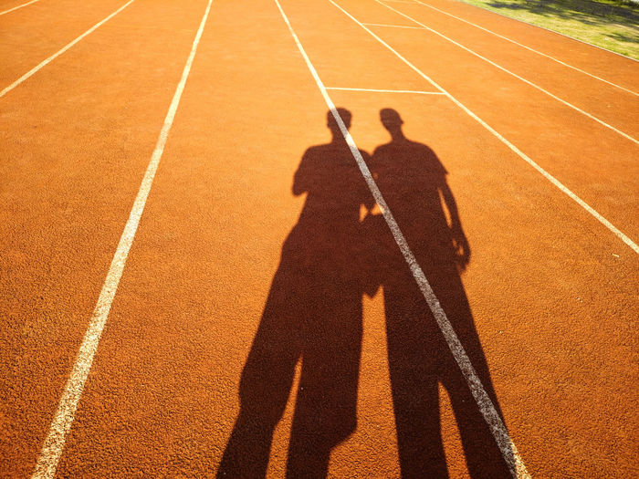 Shadow of people on sports track