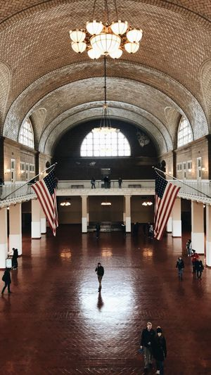 Ellis Island  New York American Flag Arch Indoors  Architecture Real People Built Structure Architectural Column Full Length Day People