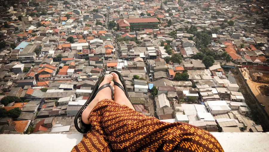 Low Section Human Leg One Person Real People Human Body Part Women Lifestyles Leisure Activity High Angle View One Woman Only Adult Day Standing Adults Only Relaxation Only Women Outdoors People Batik Indonesia Close-up