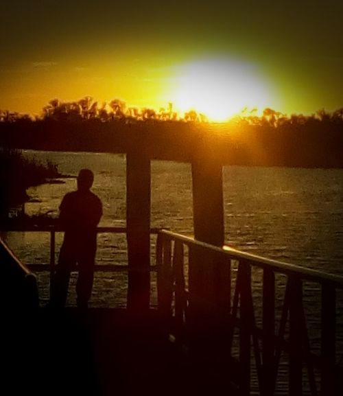 Sunset Silhouette Rear View Railing Men Adults Only One Man Only Real People Leisure Activity One Person Standing Sky Only Men People Adult Outdoors Nature Day