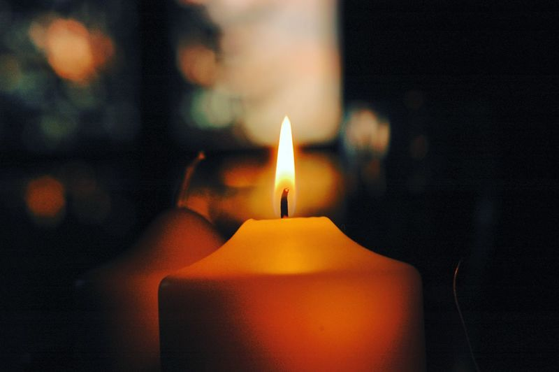 Close-up of illuminated candle