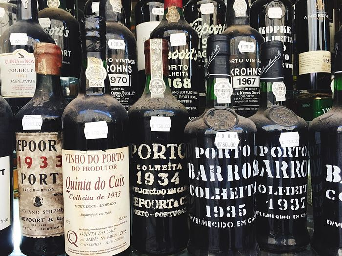 Text Bottle Wine Bottle Drink Large Group Of Objects Wine Variation Alcohol Day No People Close-up Indoors  Port Porto Vine Portwein Portugal Port Wine Red Wine Lisboa Adult Tranquility Travel Destinations Beautiful Day