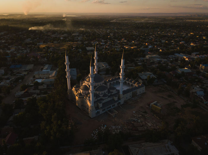 Sunset over an incomplete mosque near central Bishkek, Kyrgyzstan. Bishkek DJI Mavic Pro Sunset_collection Aerial View Architecture Building Exterior Built Structure City Cityscape Crowded Day Eyeemfresh High Angle View Illuminated Mavic Pro Mosque Muslim Nature Night Outdoors Sky Sunset Travel Destinations Week On Eyeem EyeEm Ready   Mobility In Mega Cities Stories From The City Go Higher