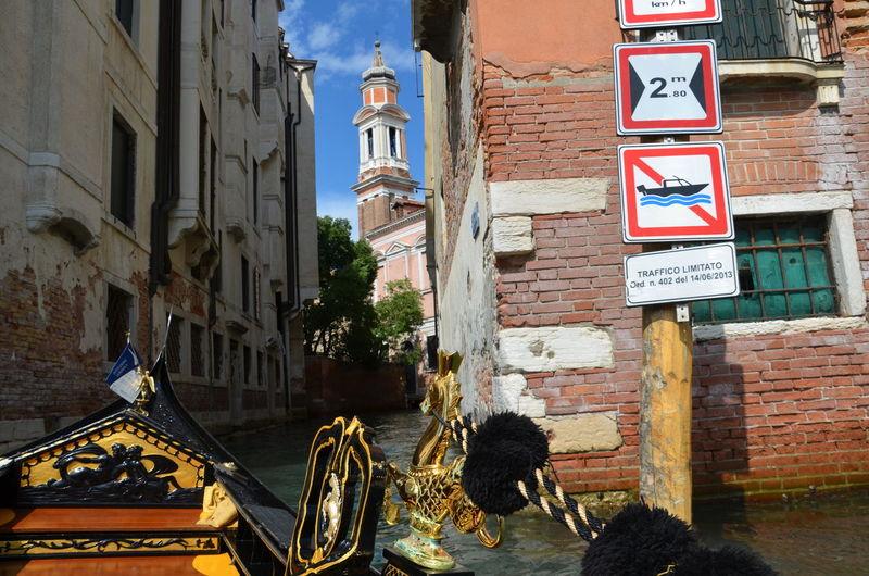 Gondola on canal amidst buildings