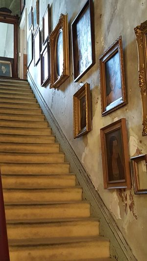 A Architecture Built Structure Day Framed Art Indoors  Low Angle View No People Old Architecture Old House Old Victorian Home Pictures On A Stair Case Pictures On Walls Staircase Standing Window