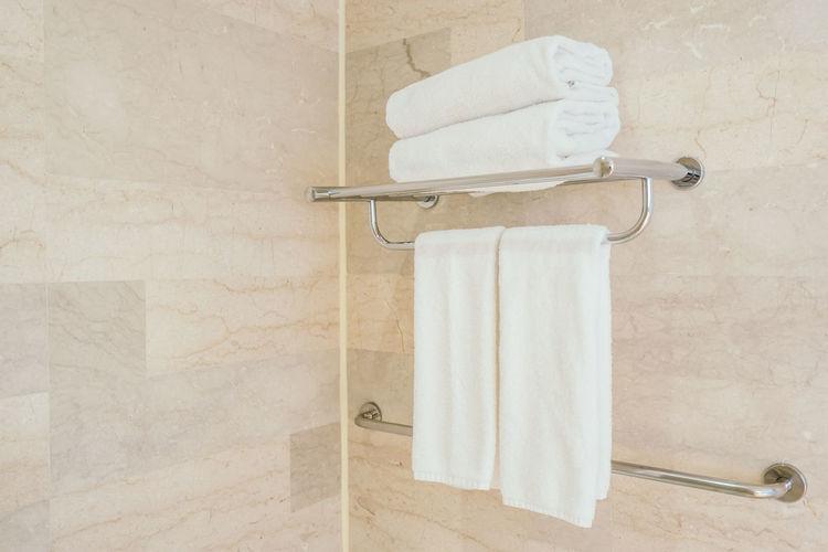Towels on rack at bathroom