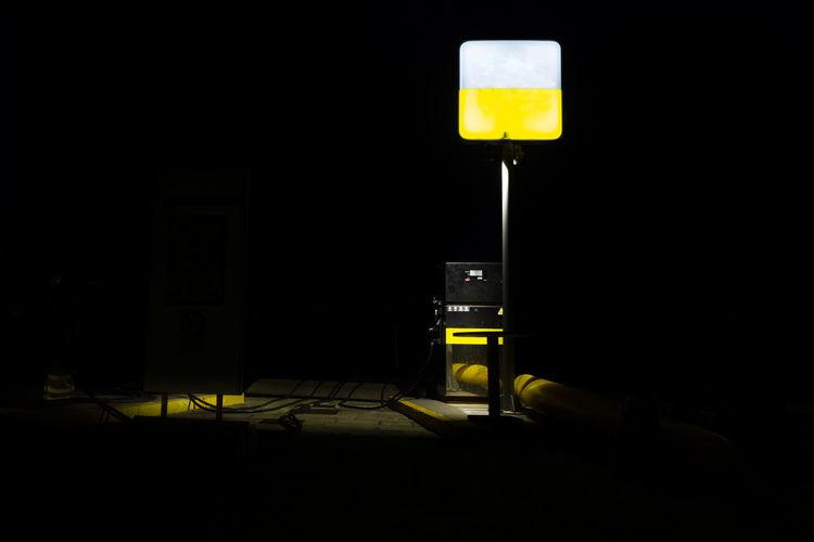 Illuminated electric lamp against dark room