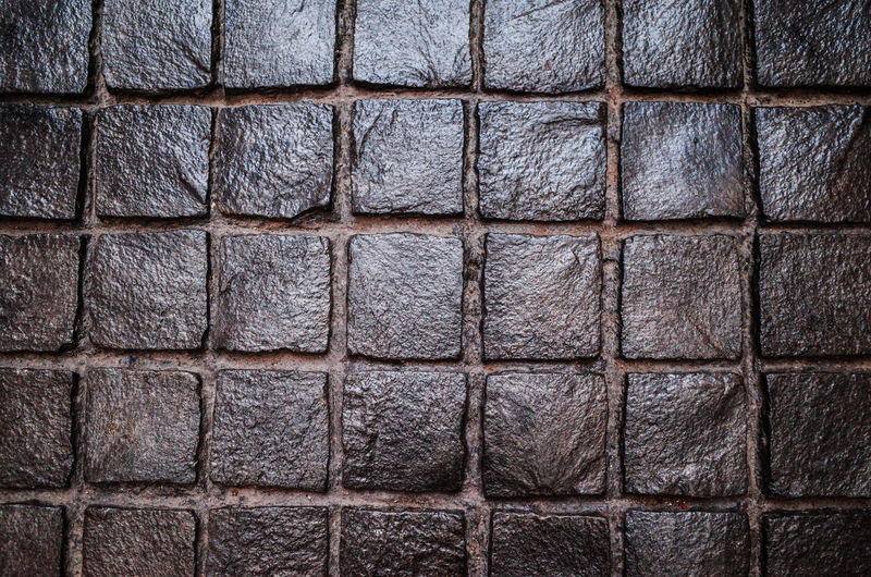 Full Frame Backgrounds Pattern Textured  Repetition No People Shape Close-up Wall - Building Feature Brick Wall Architecture Indoors  Design Geometric Shape Built Structure In A Row Stone Material Square Shape Arrangement Concrete Textured Effect
