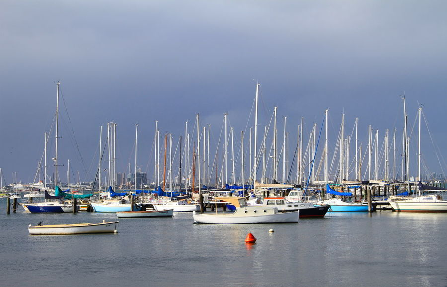 Calm before the storm Dark Clouds Over Water Harbour Marina Stormy Skies Williamstown Colored Boats Coloured Boats Day Harbor Mast Mode Of Transport Moored Nature Nautical Vessel No People Outdoors Overcast Skies Sailboat Sailing Ship Scenics Sea Sky Tranquility Transportation Yacht