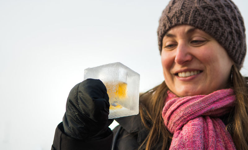 Enjoying whiskey in ice cube cup Ice Cup Ice Cube Winter Adult Alcoholic Drink Cheerful Cheers Close-up Day Front View Happiness Headshot Holding Ice Shots Knit Hat Leisure Activity One Person One Woman Only One Young Woman Only Only Women Outdoors Portrait Real People Smiling Studio Shot Warm Clothing Whiskey White Background Winter Women Young Adult Young Women