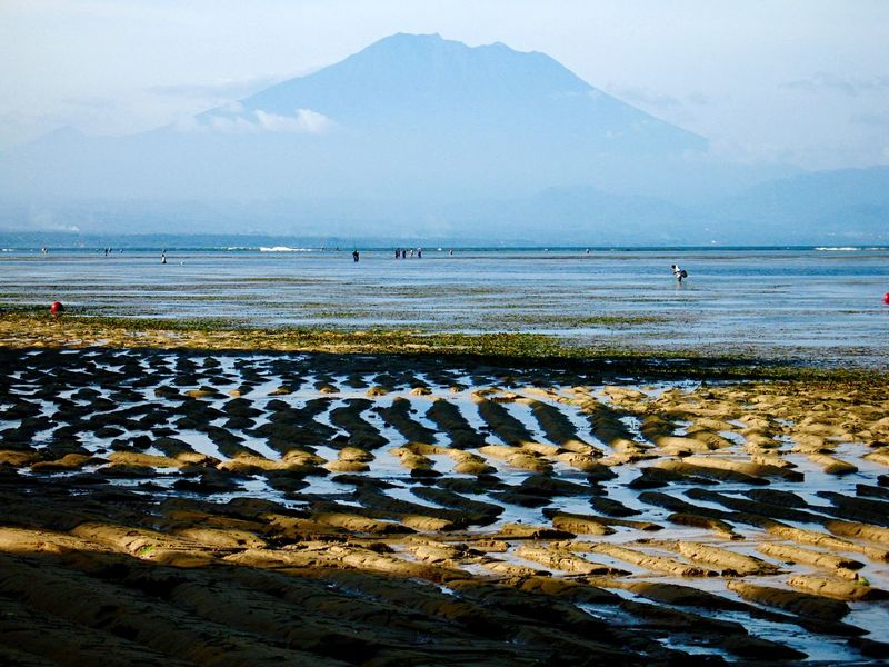 Agung Volcano Low Tide Water Mountain Beauty In Nature Scenics Nature Sea Tranquility Tranquil Scene Sky Day Mountain Range Beach Outdoors