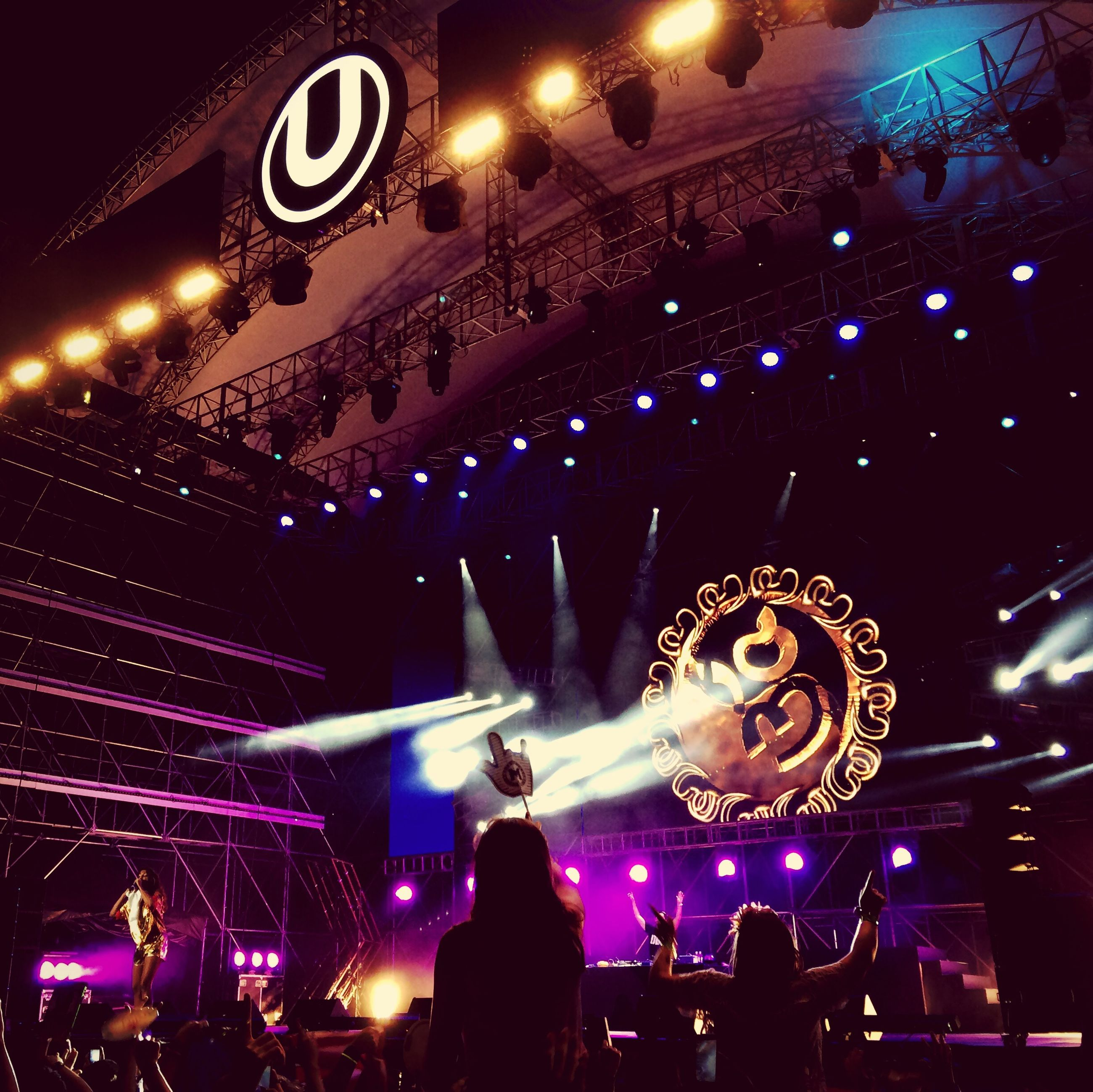 illuminated, night, arts culture and entertainment, music, large group of people, event, men, lifestyles, celebration, leisure activity, enjoyment, performance, nightlife, crowd, stage - performance space, music festival, concert, motion, stage light