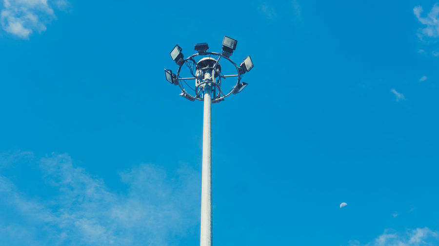 Blue Cloud - Sky Day Electric Lamp Electric Light Electrical Equipment Electricity  Floodlight Light Lighting Equipment Low Angle View Metal Nature No People Outdoors Pole Sky Street Street Light Sunlight Tall - High Technology