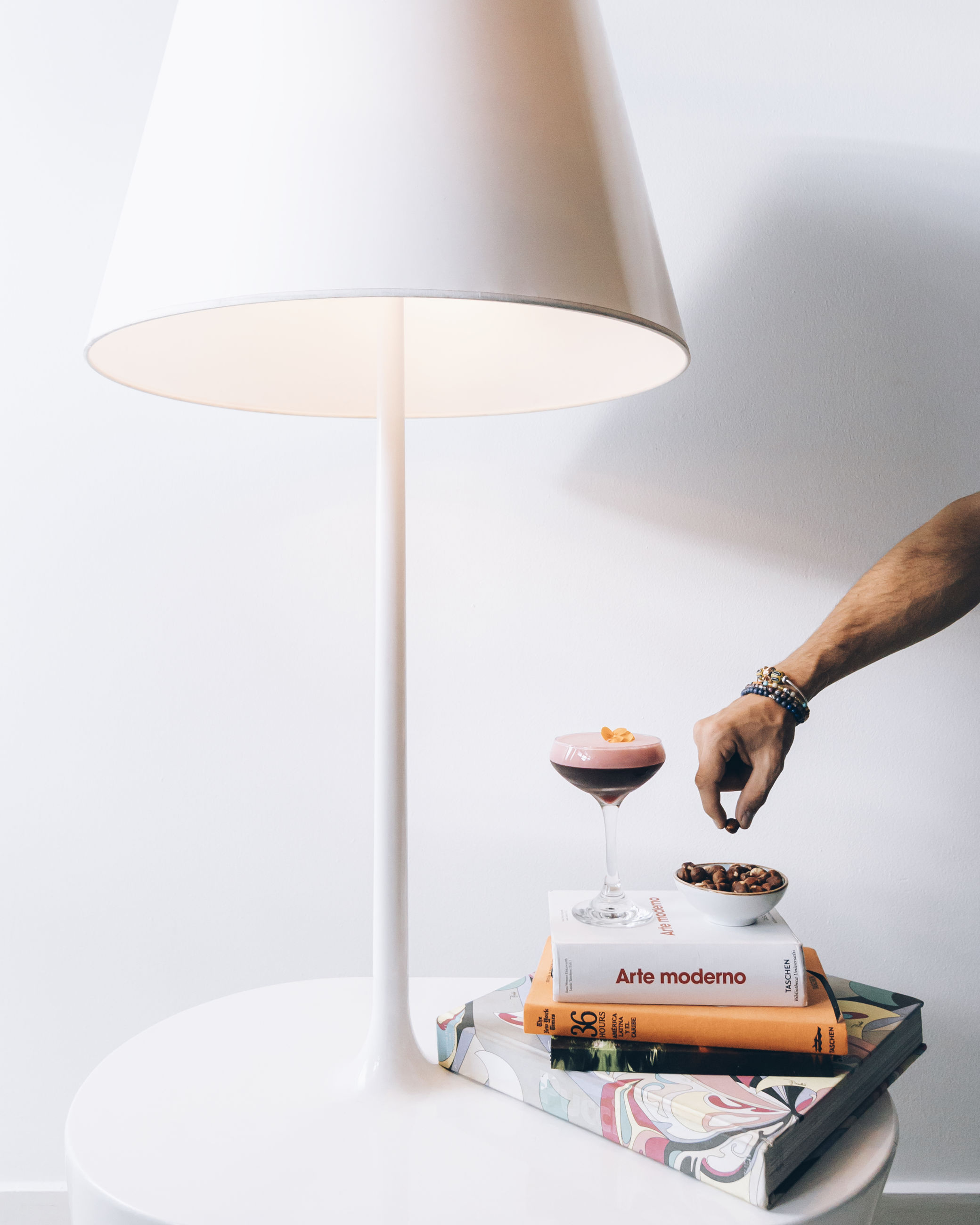 lamp, lampshade, electric lamp, lighting equipment, light fixture, indoors, lighting, table, furniture, home interior, food and drink, domestic room, lifestyles, one person, adult, food, domestic life, drink