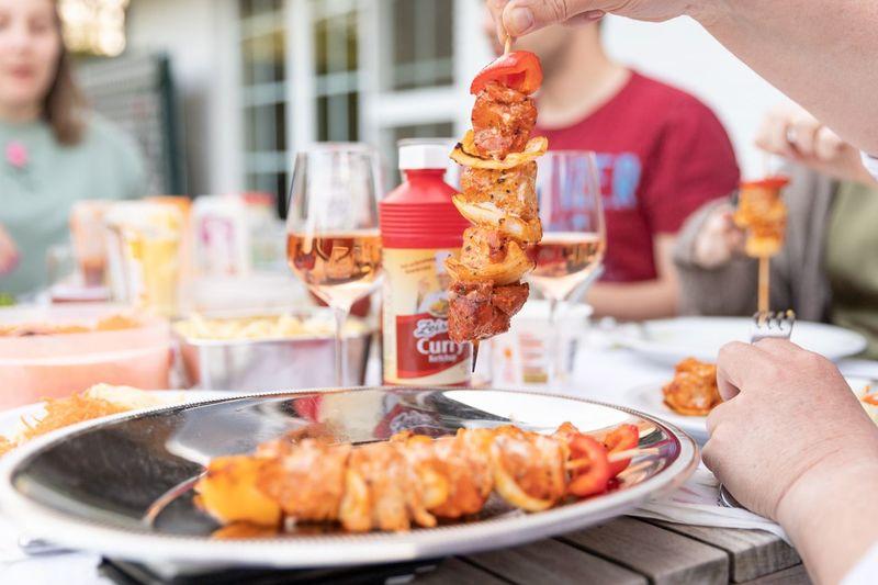 People holding food on table