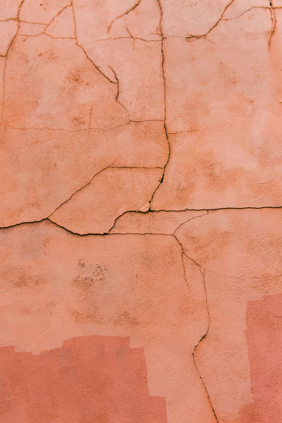 Cracked wall showing natural patterns. Abstract Atmospheric Backgrounds Colour Cracked Day Decaying Decaying Structure Detail Dirty Lines Natural Pattern No People Outdoors Paint Passing Of Time Pink Color Symbolic  Textured  Urban Wall Wall - Building Feature