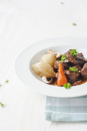 High Angle View Of Fresh Beef Stew Served On Table