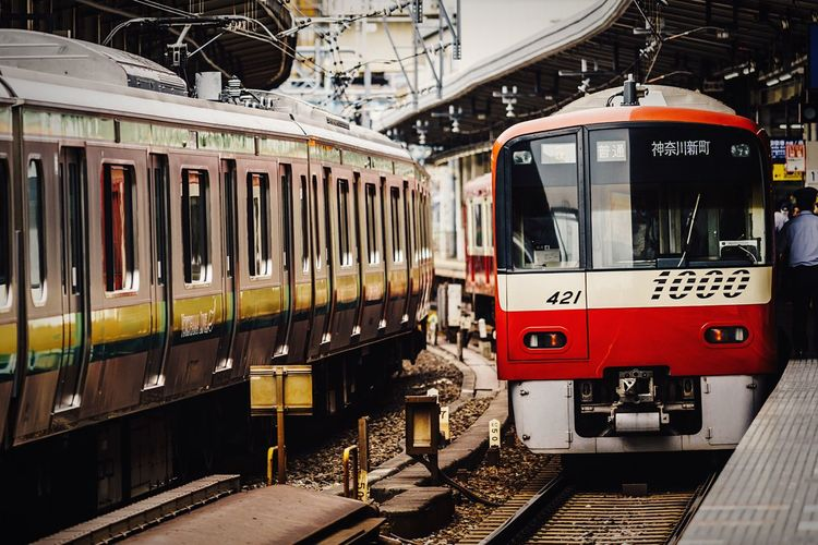 Terminal Station Stopping At The Station Commuter Train Red And White Afternoon Light Public Transportation Railroad Station Platform Railroad Track Mode Of Transport From My Point Of View City Life Urbanphotography Rail Transportation Station Light Reflection Yokohama, Japan Yokohama June 2017